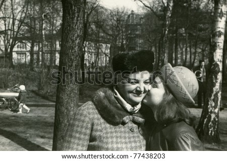 Vintage photo of young girl kissing her mother (early sixties)