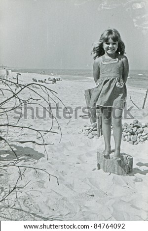 Vintage photo of young girl on beach (fifties)