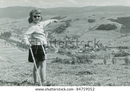 Vintage photo of young girl trekking in mountains (fifties)