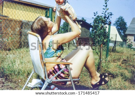 vintage photo of young mother...