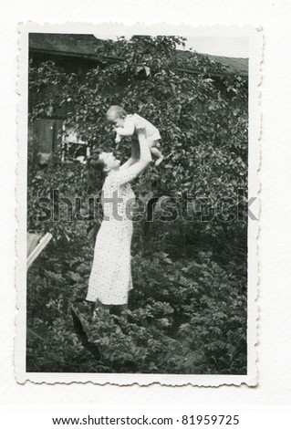 Vintage photo of young mother with baby (early forties)
