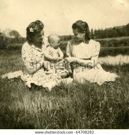 Vintage photo of young mother with her baby and her sister (forties)