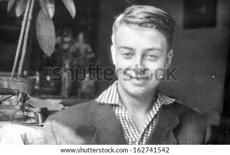 Vintage photo of young smiling boy, sixties