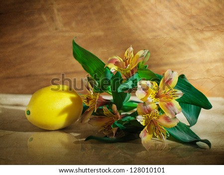 vintage photo-ripe banana and lemon in a glass of spring flowers
