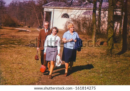 Vintage photo (scanned reversal film) - parents with adolescent daughter, sixties - stock photo