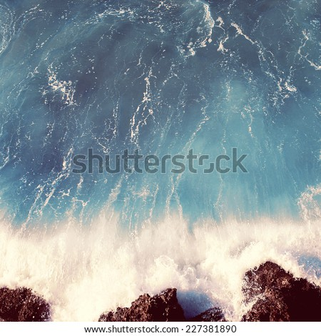 Vintage photo sea landscape, wave and rocks, soft pastel colors
