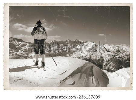 Vintage photo with old skier with traditional old wooden skis