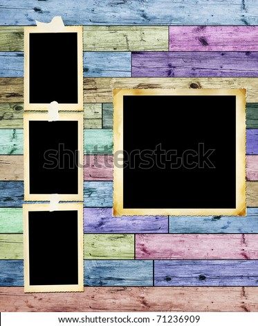 Vintage photographic blank picture frames on multicolored wooden background