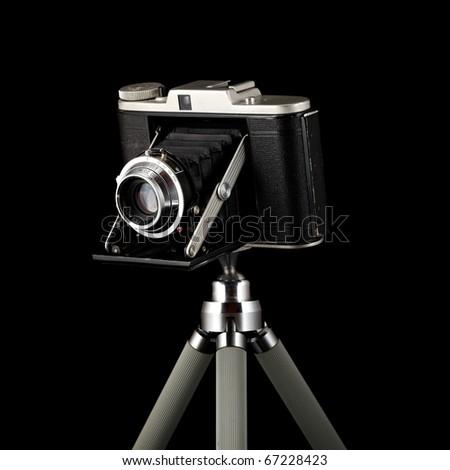 vintage photographic camera isolated on black