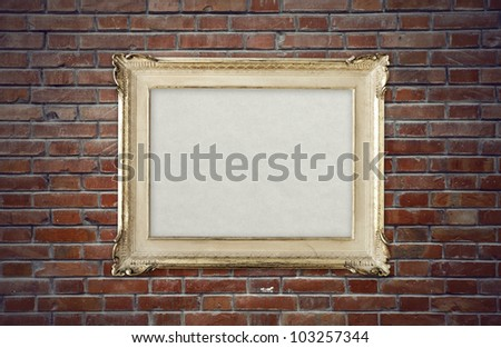 vintage picture frame on brick wall
