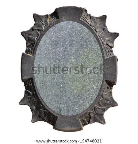 Vintage picture frame with leaf pattern and dusty mirror glass background.