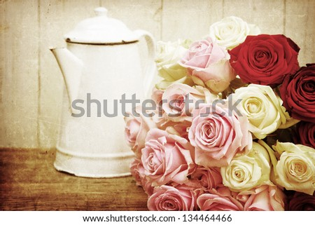 vintage picture of an shabby style arrangement with a bouquet of roses and an old coffee can
