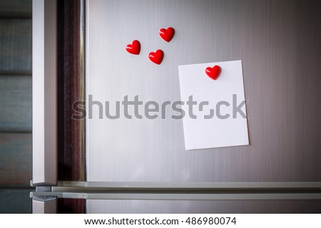 vintage picture tone of Empty paper sheet on refrigerator door. Note paper with magnetic heart. Valentine send text love message.