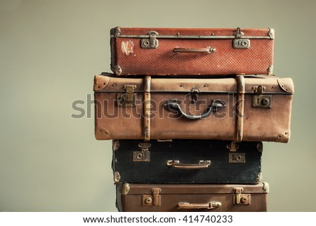 Vintage Pile Ancient Suitcases Form of Tower Design Concept Travel Luggage Traveler on Shabby Beige Background