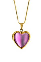 Vintage pink heart shaped locket hanging on gold chain isolated over white
