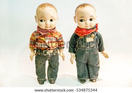 Vintage plastic dolls on white background.