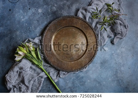 Vintage plate dish on a gray-blue concrete background, Top view