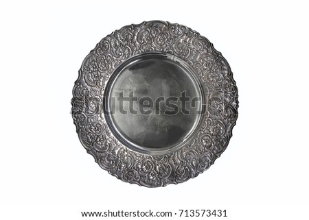 Vintage plate or tray isolated on white background. Old metal plate with decorative round floral ornate frame. #713573431