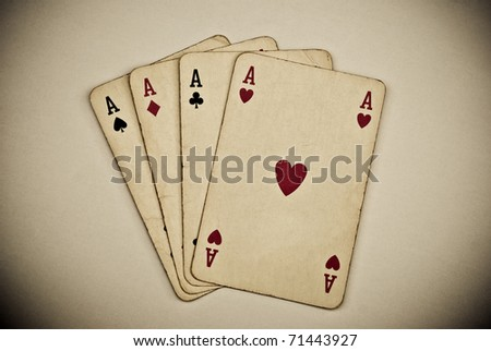 vintage playing cards on grey background