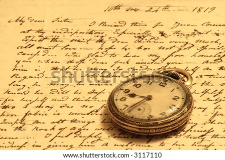 Vintage pocket-watch and old hand-written personal letter.