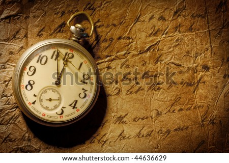 Vintage pocket-watch and old hand-written personal letter