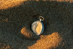 vintage pocket watch in the sand beach
