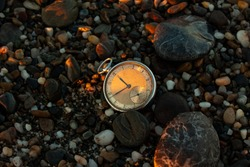 Vintage pocket watch on the beach
