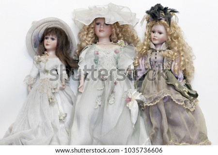 Vintage porcelain dolls found on the flea market, isolated