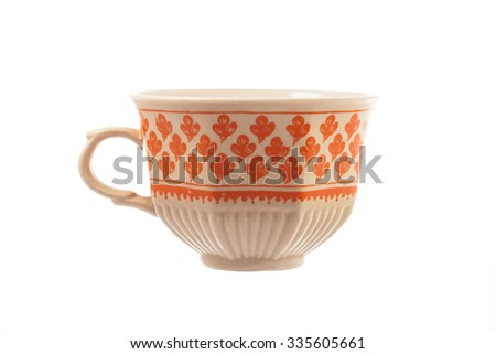 Vintage porcelain tea or coffee cup isolated on white background