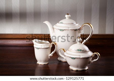 Vintage porcelain teapot and circles on a table