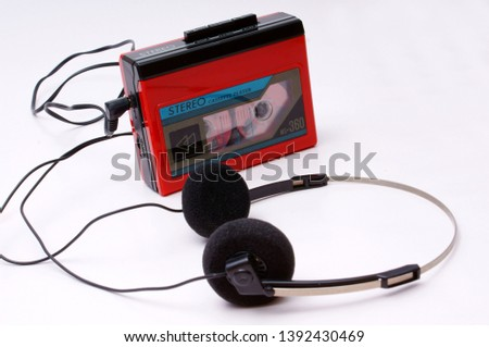 vintage portable cassette player from the 80s with headphones #1392430469