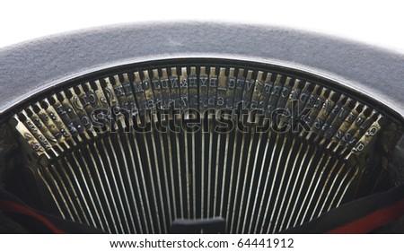 Vintage portable typewriter keys on white.