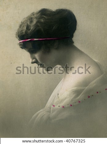 Vintage portrait of a young girl. The shot was taken around 1918 year. - stock photo
