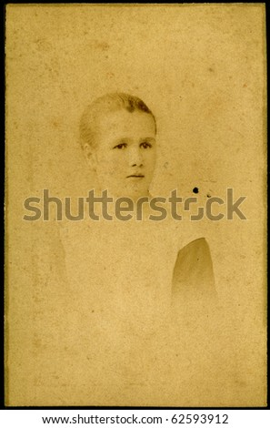 Vintage portrait of a young girl. The shot was taken around 1921 year. - stock photo