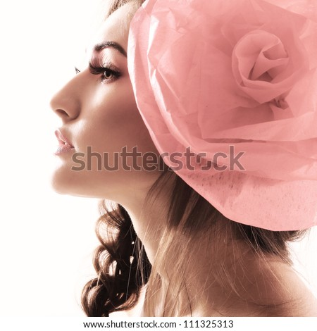 Vintage portrait of fashion glamour girl with red flower in her hair. Studio shot
