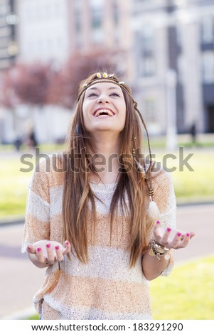 Vintage portrait of hippie young woman smiling with excitement.