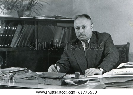 Vintage portrait of man in his office (fifties)