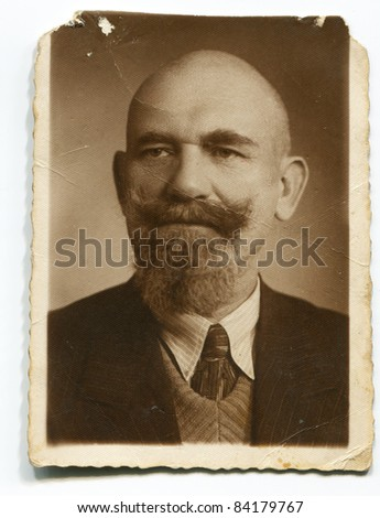 Vintage portrait of man with mustache and bread (thirties)