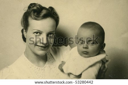 Vintage portrait of mother with her baby (forties)