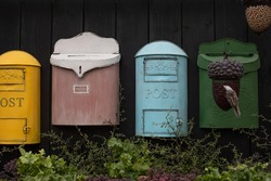 Vintage postbox, decorative set. Old fashioned mailboxes red blue green, garden decoration. Wall decoration in vintage style