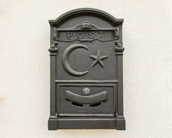 vintage postbox with star and crescent