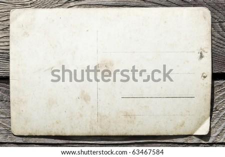 Vintage postcard on wooden background