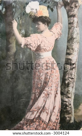 Vintage postcard with handpainted photograph of beautiful lady in fashion  dress of 1910