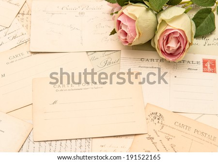 vintage postcards and soft rose flowers. old love letters. romantic still life
