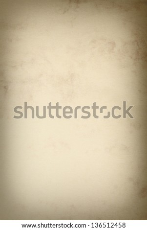 Vintage poster paper texture with a glowing center and grunge vignette abstract background