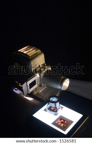 Vintage projector and lightbox with lupe