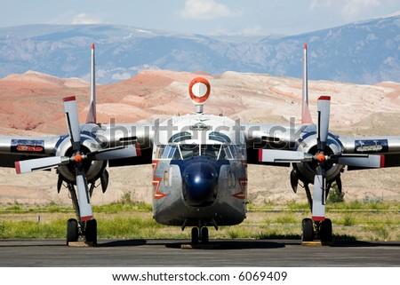 vintage propeller aircraft closeup parked on tarmac