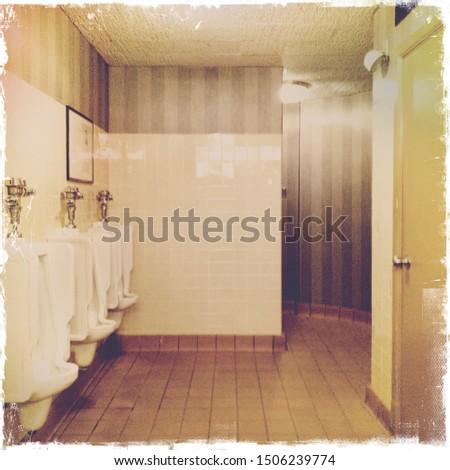 Vintage public men's restroom with sink, urinals and stalls #1506239774