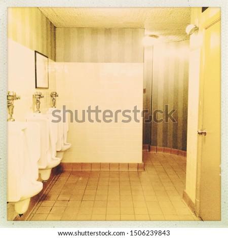 Vintage public men's restroom with sink, urinals and stalls #1506239843
