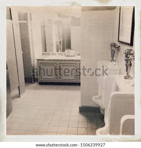 Vintage public men's restroom with sink, urinals and stalls #1506239927
